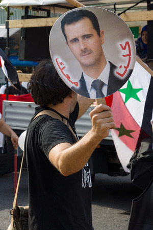 BERLIN, GERMANY - AUGUST 03, 2013: International Quds Day. A group of demonstrators supporting the policy of Syrian President Bashar Hafez al-Assad.