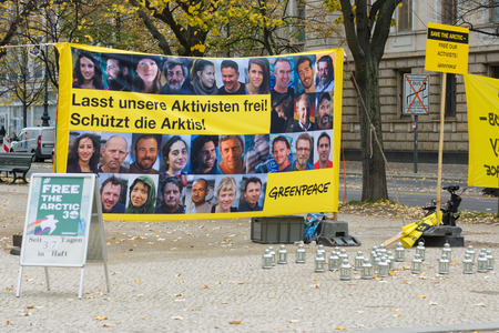 activists: BERLIN, GERMANY - OCTOBER 25, 2013: The protest by Greenpeace activists in front of the Russian Embassy in Berlin in support of arrested Arctic Sea crew.