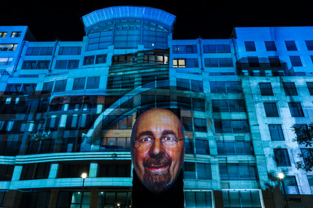 BERLIN - OCTOBER 08, 2016: Festival of lights. Historical projection on the facade of the new shopping center Mall of Berlin at Potsdamer Platz.