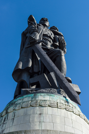 Soviet War Memorial (Treptower Park). Monument - Warrior-Liberator with a sword and holding a little girl in her arms.