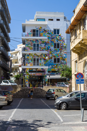 nicely: HERAKLION, GREECE - JULY 09, 2016: Crete. Nicely painted building in the historic center of the city. Heraklion - the largest city on the island.