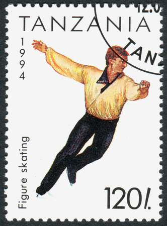 olympics: TANZANIA - CIRCA 1994: A stamp printed in Tanzania dedicated to Winter Olympics Game in Lillehammer, shows Figure Skating, circa 1994 Editorial