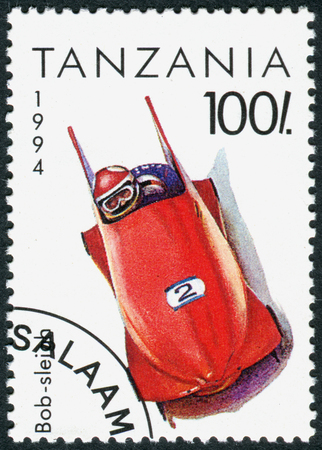 olympics: TANZANIA - CIRCA 1994: A stamp printed in Tanzania dedicated to Winter Olympics Game in Lillehammer, depicted Bobsleigh, circa 1994 Editorial