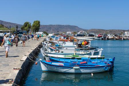 elite: CRETE, GREECE - JULY 11, 2016: The embankment of a small elite tourist town - Elounda, municipality of Agios Nikolaos.