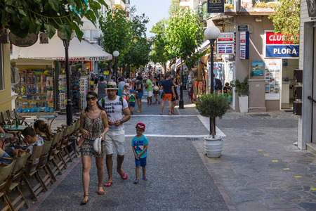 elite: CRETE, GREECE - JULY 11, 2016: The narrow shopping streets of a coastal elite tourist town Agios Nikolaos on the Greek island of Crete.
