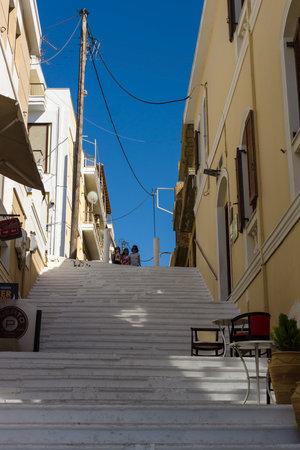 elite: CRETE, GREECE - JULY 11, 2016: The narrow streets of a coastal elite tourist town Agios Nikolaos on the Greek island of Crete.