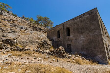 The ruins of the leper colony closed in the 50s on the ruins of a Venetian fortress on Spinalonga island. Crete. Greece. Stock Photo