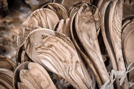 Kitchen utensils from olive wood. Traditional Cretan souvenirs. Greece. Stylization. Toning.