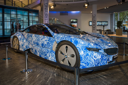 plugin: BERLIN - NOVEMBER 07, 2013: Showroom. The BMW i8 Prototype, first introduced as the BMW Concept Vision Efficient Dynamics, is a plug-in hybrid sports car developed by BMW. Editorial