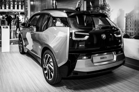 i3: BERLIN - NOVEMBER 07, 2013: Showroom. The BMW i3, previously Mega City Vehicle (MCV), is a five-door urban electric car developed by the German manufacturer BMW. Black and white.