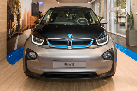 developed: BERLIN - NOVEMBER 07, 2013: Showroom. The BMW i3, previously Mega City Vehicle (MCV), is a five-door urban electric car developed by the German manufacturer BMW.