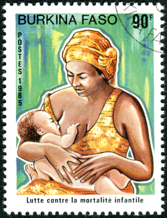 BURKINA FASO - CIRCA 1986: A stamp printed in Burkina Faso, dedicated to Fight against infant mortality, shows Mother with her child, circa 1986