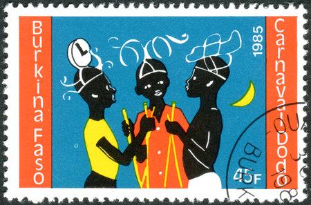 BURKINA FASO - CIRCA 1986: A stamp printed in Burkina Faso, dedicated to Dodo Carnival, shows three young dancers, circa 1986