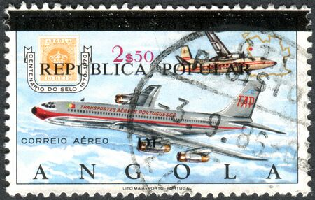 overprint: ANGOLA - CIRCA 1970: A stamp printed in Angola (overprint 1980), shows the Boeing 707 jet aircraft, circa 1970 Editorial