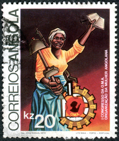 oma: ANGOLA - CIRCA 1983: A stamp printed in Angola, dedicated to 1st Congress of O.M.A. - Organization of Angolan Women, shows a woman with a shovel and a weapon, circa 1983 Editorial