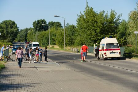 marzahn: BERLIN - JULY 21, 2013: The fire of construction trailer. District of Marzahn-Hellersdorf. The arrival of the ambulance car.