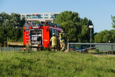 extinguishing: BERLIN - JULY 21, 2013: The fire of construction trailer. District of Marzahn-Hellersdorf. The arrival of fire truck. Fire brigade at work.