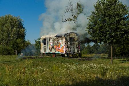 marzahn: BERLIN - JULY 21, 2013: The fire of construction trailer. District of Marzahn-Hellersdorf. Editorial