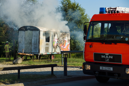 marzahn: BERLIN - JULY 21, 2013: The fire of construction trailer. District of Marzahn-Hellersdorf. The arrival of fire truck. Fire brigade at work.