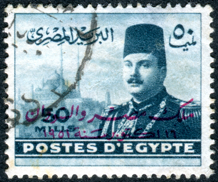 farouk: EGYPT - CIRCA 1947: A stamp printed in Egypt, shows the King Farouk in front of Cairo Citadel, circa 1947 Editorial