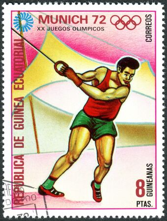 EQUATORIAL GUINEA - CIRCA 1972: A stamp printed in Equatorial Guinea, devoted to Summer Olympics Games in 1972, Munich, shows the Hammer Throw, circa 1972