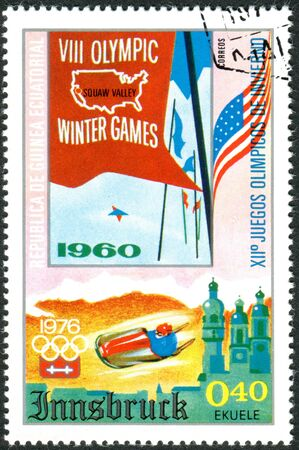 equatorial guinea: EQUATORIAL GUINEA - CIRCA 1975: A stamp printed in Equatorial Guinea, devoted to Winter Olympics Games 1976, Innsbruck, shows the posters of previous games in Squaw Valley, 1960, circa 1975