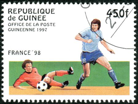 GUINEA - CIRCA 1997: A stamp printed in Guinea dedicated to the FIFA World Cup 1998 - France, shows the Game scene, circa 1997 Editorial