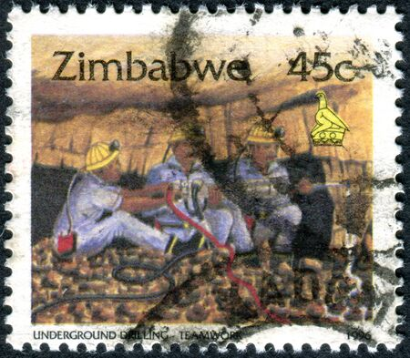 zimbabwe: ZIMBABWE - CIRCA 1996: A stamp printed in Zimbabwe, shows the Underground Drilling - Teamwork, circa 1996 Editorial