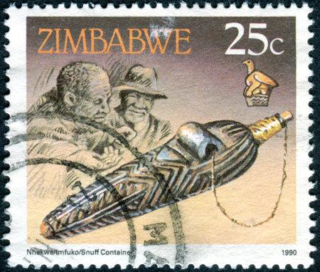 tabaco: ZIMBABWE - alrededor de 1990: Un sello impreso en Zimbabwe, muestra el recipiente Tabaco, alrededor de 1990