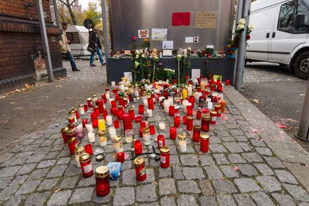 muhammad: BERLIN - OCTOBER 30, 2015: Centre for the reception and registration of refugees - LaGeSo. Grave lights for the dead child Muhammad, from the family of refugees from Bosnia.