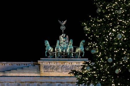quadriga: A fragment of the Brandenburg Gate (Quadriga close-up) and a fragment of a Christmas tree in the foreground. Stock Photo