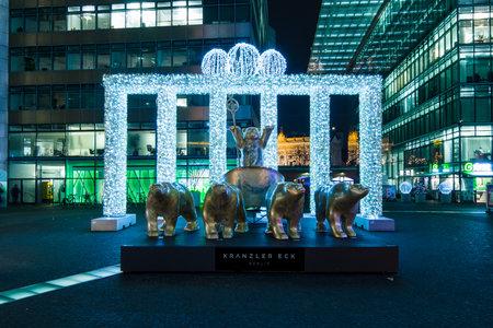 quadriga: BERLIN - DECEMBER 07, 2016: Neues Kranzler Eck. West Berlin. Installation - the Brandenburg Gate in the Christmas illuminations and the symbol of the city - Buddy Bear Quadriga.