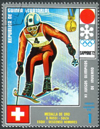 EQUATORIAL GUINEA - CIRCA 1972: A stamp printed in Equatorial Guinea, shows the Bernhard Russi - Medalists of the Winter Olympics 1972, Sapporo, circa 1972 Éditoriale