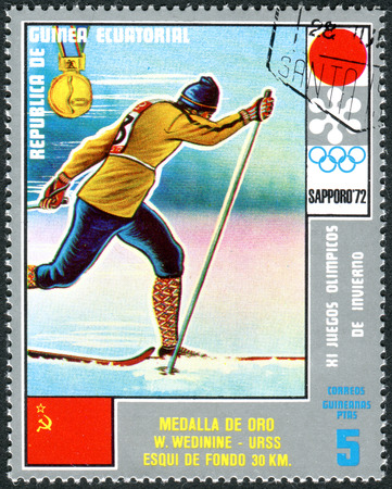 EQUATORIAL GUINEA - CIRCA 1972: A stamp printed in Equatorial Guinea, shows the Vyacheslav Petrovich Vedenin - Medalists of the Winter Olympics 1972, Sapporo, circa 1972 Éditoriale