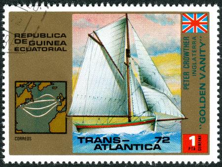 equatorial guinea: EQUATORIAL GUINEA - CIRCA 1973: A stamp printed in Equatorial Guinea, devoted to the Trans Atlantica sailing regatta, shows yacht Golden Vanity, circa 1973