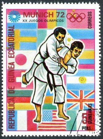 equatorial guinea: EQUATORIAL GUINEA - CIRCA 1972: A stamp printed in Equatorial Guinea, devoted to the Summer Olympics 1972, Munich, shows a sports disciplines - Judo, circa 1972