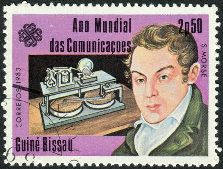 samuel: GUINEA - BISSAU - CIRCA 1983: A stamp printed in Guinea-Bissau, dedicated to the World Communications Year, shows an American painter and inventor Samuel Morse, circa 1983