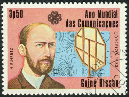 physicist: GUINEA - BISSAU - CIRCA 1983: A stamp printed in Guinea-Bissau, dedicated to the World Communications Year, shows a German physicist Heinrich Hertz, circa 1983