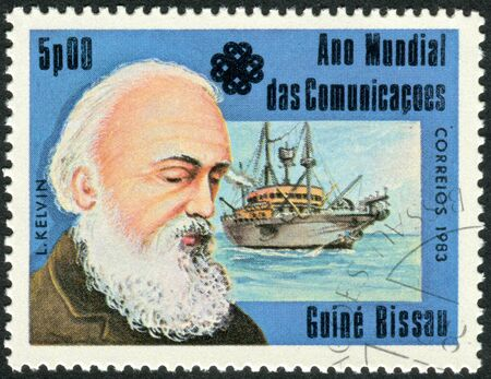 physicist: GUINEA - BISSAU - CIRCA 1983: A stamp printed in Guinea-Bissau, dedicated to the World Communications Year, shows a Scots-Irish mathematical physicist and engineer William Thomson, 1st Baron Kelvin, circa 1983