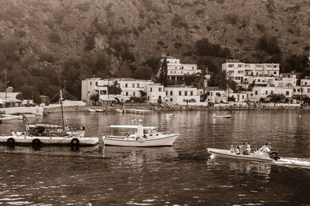 sepia toning: CRETE, GREECE - JULY 14, 2016: Beautiful bay. The village Loutro, Chania region of Crete. Loutro is accessible only by foot or by sea. Sepia toning.