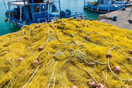 Fishing nets on the quayside. Stock Photo