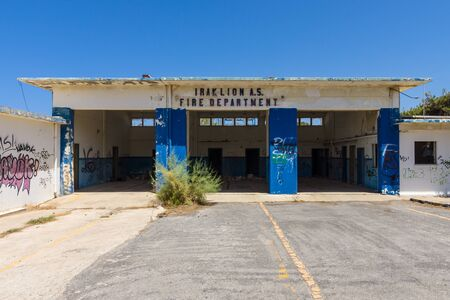 fire brigade: HERAKLION, GREECE - JULY 16, 2016: Abandoned building fire brigade in the former Iraklion Air Station (7276th Air Base Group 1954 - 1993) of United States Air Force.