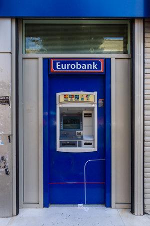 largest: HERAKLION, GREECE - JULY 16, 2016: ATM Eurobank Ergasias. Eurobank Ergasias is the third largest bank in Greece.