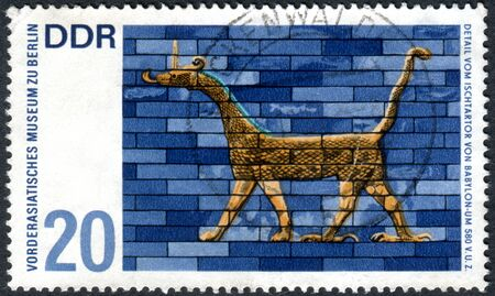GERMANY - CIRCA 1966: A stamp printed in Germany (GDR), shows the detail from Ishtar Gate, Babylon. Artwork from Near Eastern Museum, Berlin, circa 1966