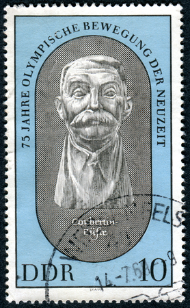 forster: GERMANY - CIRCA 1969: A stamp printed in Germany (GDR), dedicated to the revival of the Olympic Games, shows the bust of Pierre de Coubertin by Wieland Forster, circa 1969 Editorial