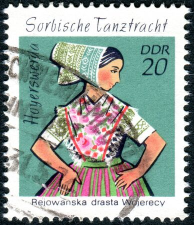 GERMANY - CIRCA 1971: A stamp printed in Germany (GDR), shows the Sorbian Dance Costumes from Hoyerswerda, circa 1971