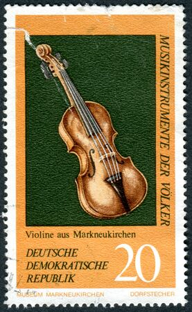 GERMANY - CIRCA 1971: A stamp printed in Germany (GDR), shows the musical instrument from Germany, Violin, circa 1971 Editorial