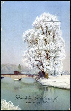 christamas: SWITZERLAND - CIRCA 1920: A Christamas postcard printed in Switzerland shows a winter landscape. The inscription in German: Happiness in the New Year, circa 1920 Editorial