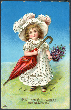 ittle: GERMANY - CIRCA 1907: A greeting postcard printed in Germany, shows a little girl with a hat and umbrella. The inscription in German: Happy birthday, circa 1907