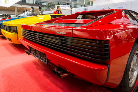 STUTTGART, GERMANY - MARCH 02, 2017: Rear view of various modifications of sports cars Ferrari Testarossa and F512. Europes greatest classic car exhibition RETRO CLASSICS